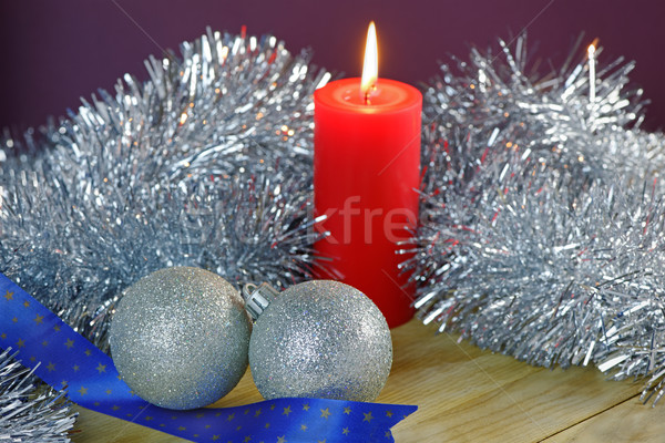 Christmas Baubles and Candle with Tinsel Stock photo © rogerashford