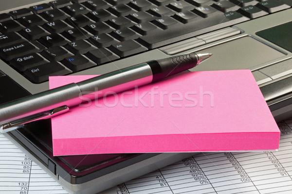 Laptop jegyzettömb üzlet papír munka billentyűzet Stock fotó © rogerashford