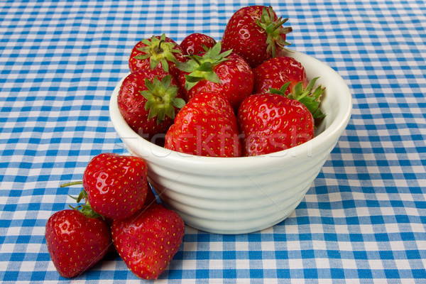 Bowl of Strawberries on a Blue Gingham Tablecloth Stock photo © rogerashford