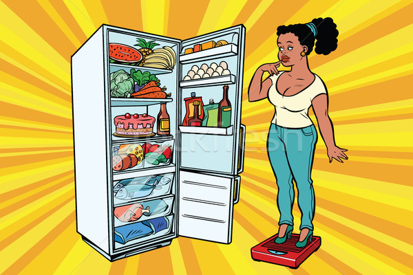Stock photo: Diet. Young woman on scales, stand next to the refrigerator with