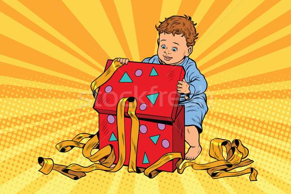 Pop art boy opens the gift box Stock photo © rogistok