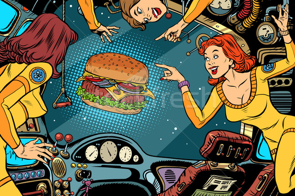 Women astronauts in the cabin of a spaceship and Burger Stock photo © rogistok