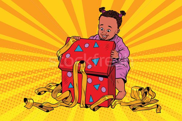 Pop art girl opens the gift box Stock photo © rogistok