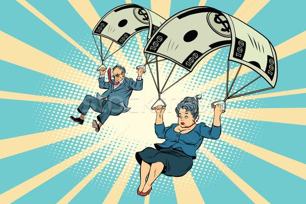 Dorado paracaídas financieros empresario negocios mujer de negocios Foto stock © rogistok