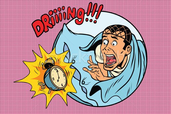 Man wakes up alarm clock Stock photo © rogistok