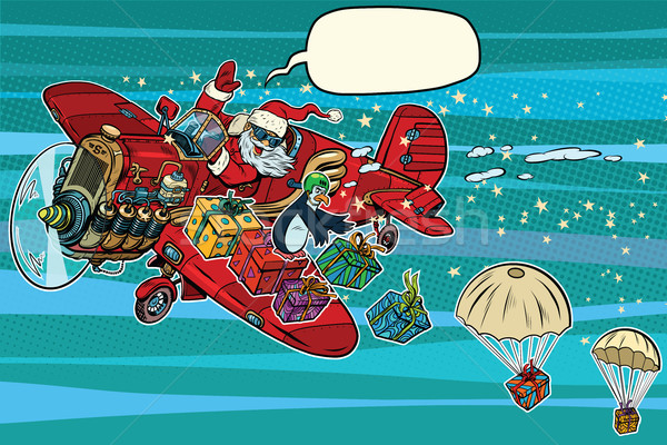 Santa Claus on vintage planes dropped Christmas gifts Stock photo © rogistok