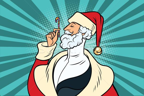Elegant Santa Claus and candy Stock photo © rogistok