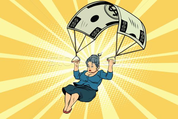 Vrouw gouden parachute financiële zakenvrouw business Stockfoto © rogistok