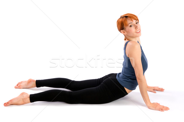 Smiling Fit Woman doing Yoga Exercise Stock photo © rognar