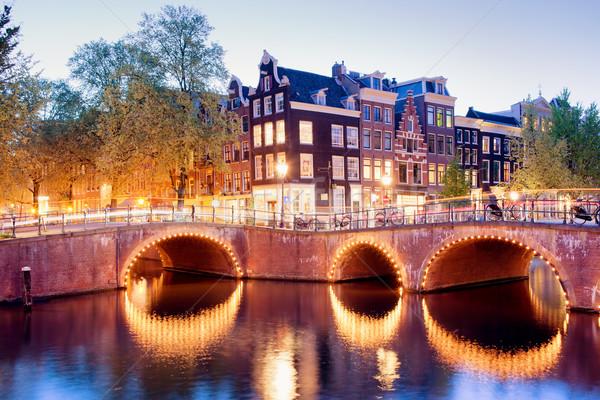Luci Amsterdam canale ponti sera Foto d'archivio © rognar