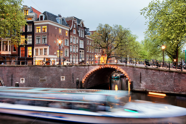 Canal Bridge and Boat Tour in Amsterdam at Evening Stock photo © rognar