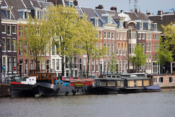 Houseboats and Houses in Amsterdam Stock photo © rognar