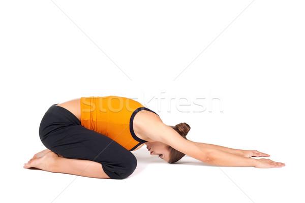 Woman Doing Extended Child Pose Yoga Asana Stock photo © rognar