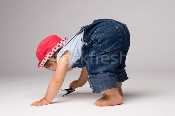 Kislány játszik egyéves lány farmer padló Stock fotó © rognar