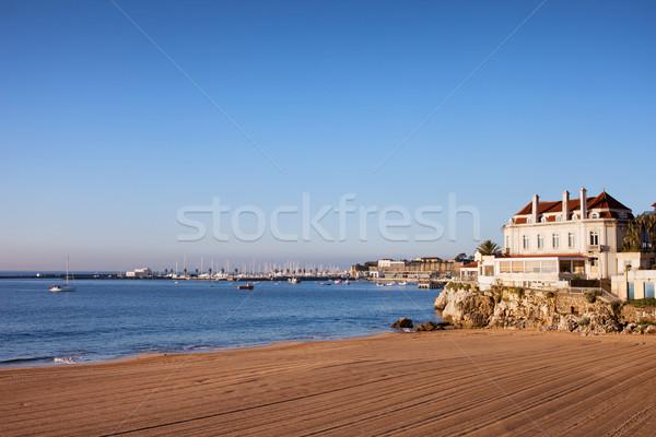 Strand zonsopgang oceaan water gebouw landschap Stockfoto © rognar