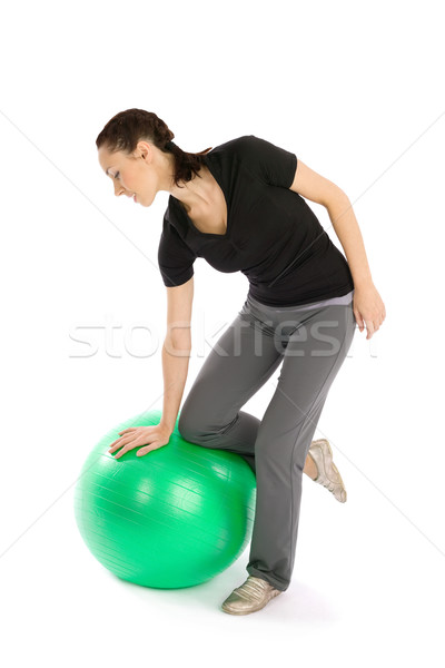 Stock photo: Woman with a Pilates Ball