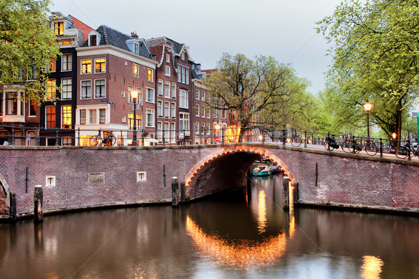 Canal Bridge in Amsterdam at Evening Stock photo © rognar