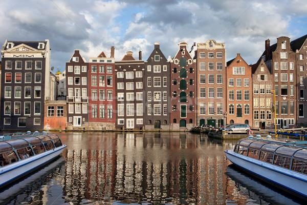 Cidade Amsterdam pôr do sol Holanda holandês estilo Foto stock © rognar