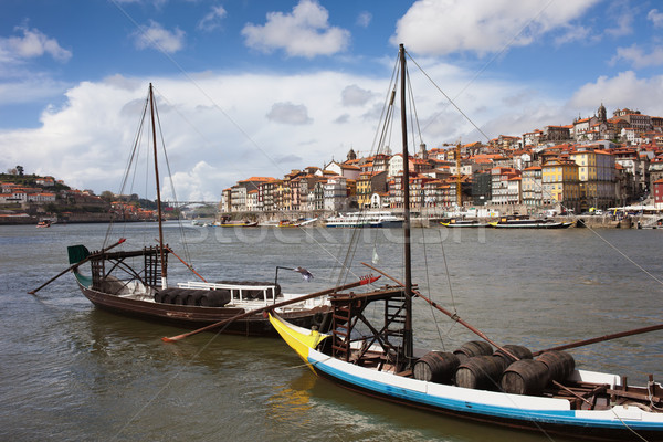 Boats with Wine Barrels on Douro River in Porto Stock photo © rognar