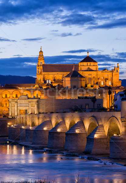 Puente Romano and Mezquita at Twilight in Cordoba Stock photo © rognar