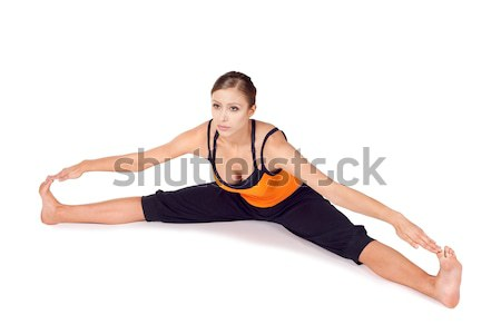 Woman Practicing Twist Pose Yoga Exercise Stock photo © rognar