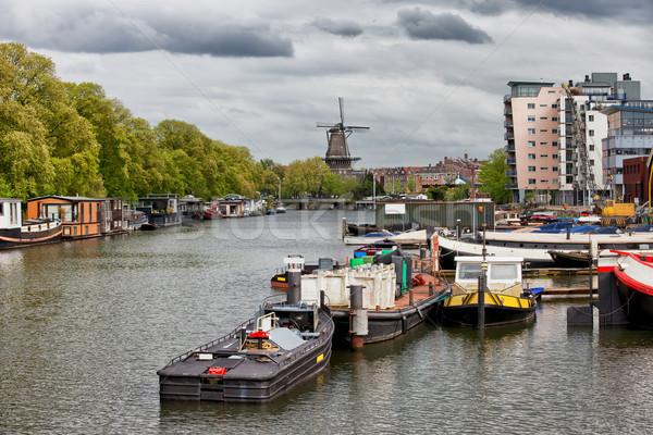 Amsterdam Cityscape kanal tekneler fırıldak ufuk Stok fotoğraf © rognar