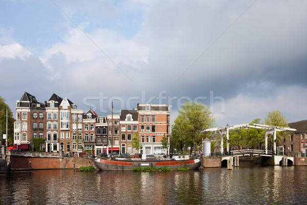 Stock photo: Dutch Houses by the Amstel River in Amsterdam