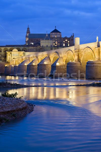 Stock photo: Roman Bridge on Guadalquivir River at Dawn