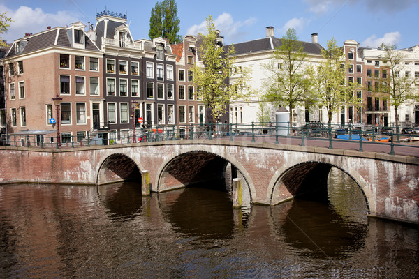 Bridge over Canal and Houses in Amsterdam Stock photo © rognar