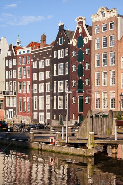 Amsterdam casas pôr do sol pitoresco velho canal Foto stock © rognar