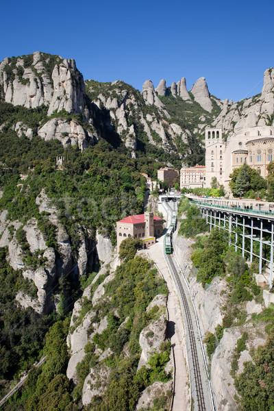 Montanhas cremalheira ferrovia mosteiro edifício Foto stock © rognar