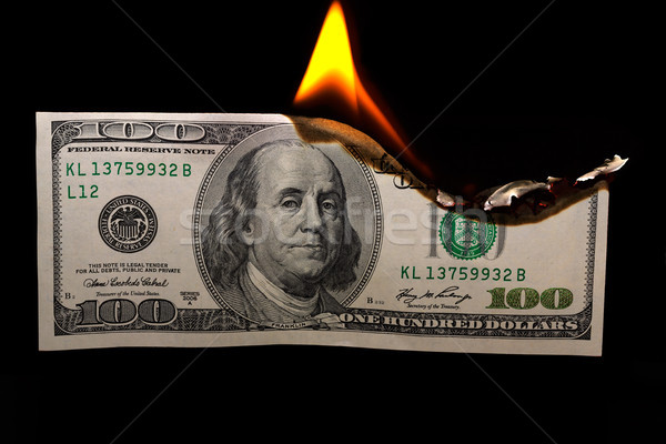 Burning dollars Stock photo © Roka