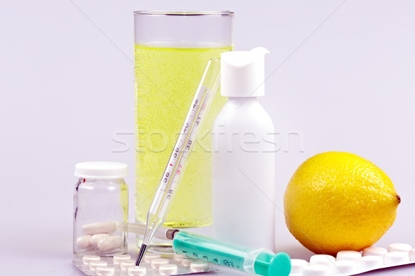 Stock photo: Medical supplies, tablets and capsules, spray throat and drink