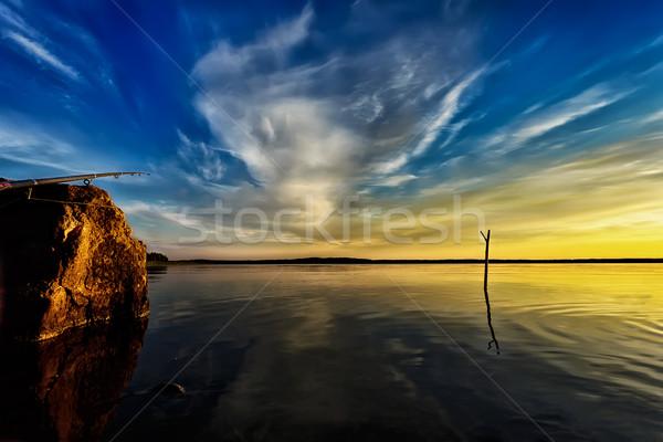 Halászat naplemente drámai gyönyörű tó égbolt Stock fotó © Roka