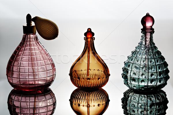 Parfüm üvegek konténer tükröződés fény szépség Stock fotó © Roka
