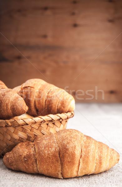 круассаны корзины деревянный стол покрытый грубо ткань Сток-фото © Romas_ph