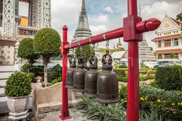 Buddhist bells at Wat Arun in Bangkok Stock photo © romitasromala