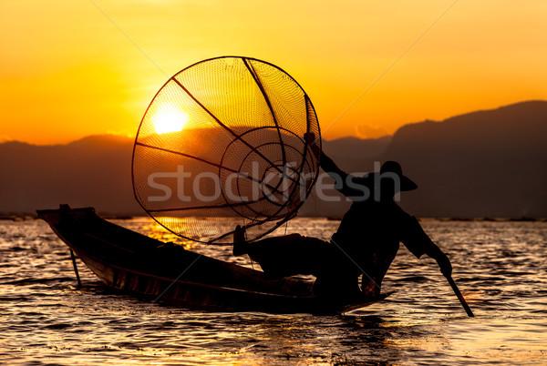 Wygaśnięcia rybaka jezioro ludzi turystycznych cel Zdjęcia stock © romitasromala
