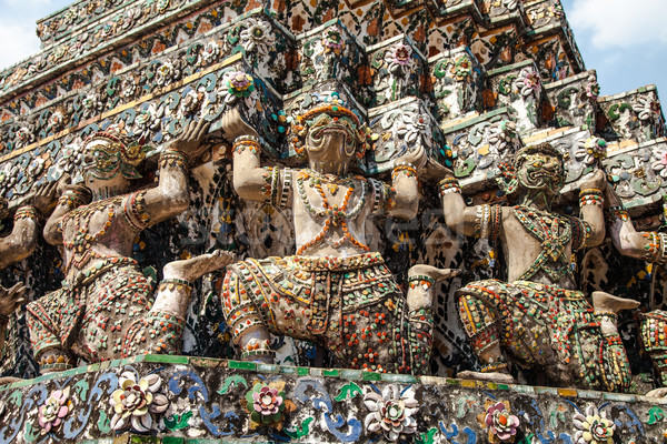 Demon Guardian statues at Wat Arun temple Stock photo © romitasromala
