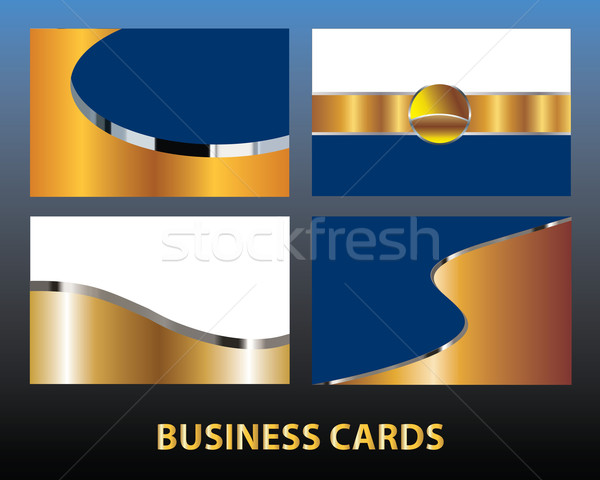 Four blank gold business cards Stock photo © ronfromyork