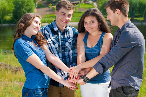 Boldog négy tinédzserek kézfogás nő férfi Stock fotó © rosipro