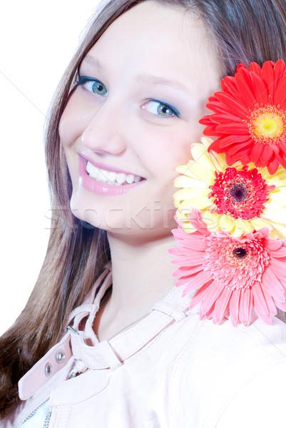 Belo mulher jovem três flores mulher Foto stock © rosipro
