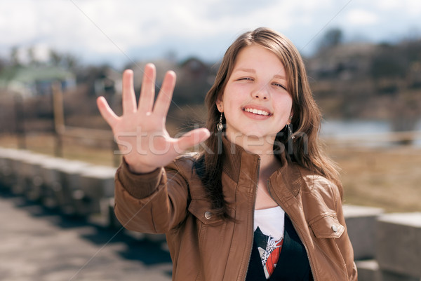 Feliz menina adolescente cinco belo sorridente Foto stock © rosipro