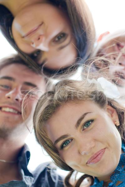 Boldog négy tini barátok lefelé néz férfi Stock fotó © rosipro