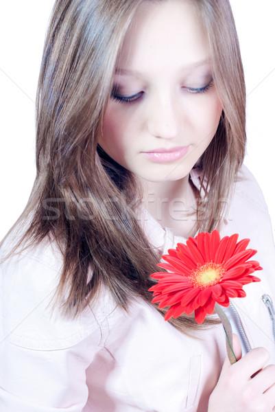 Gyönyörű fiatal nő tart piros virág nő Stock fotó © rosipro