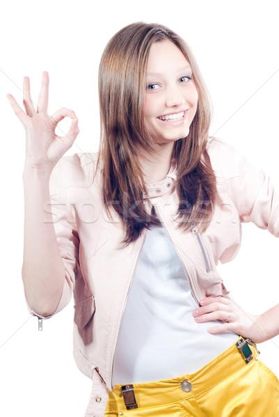 Gyönyörű boldog fiatal nő mutat oké izolált Stock fotó © rosipro