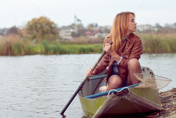Young woman on a boat Stock photo © rosipro