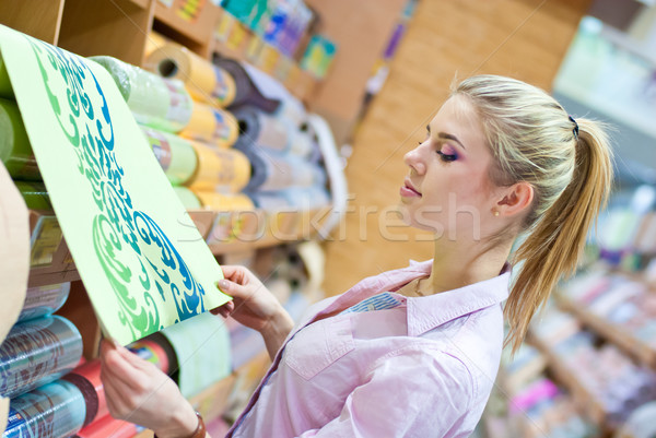 Woman with rolls of wallpaper Stock photo © rosipro