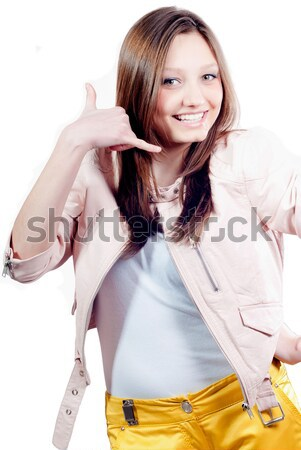 Beautiful happy young woman showing call me Stock photo © rosipro