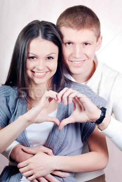 Boldog fiatal pér szív szimbólum átkarol mosolyog Stock fotó © rosipro